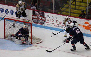 Muskegon's Griffen Molino takes the puck behind Team USA goalie Jake Oettinger. Photo/Jason Goorman