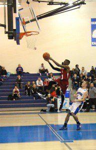 Dev'ron Williams tries for the layup on the fast break. Photo/Jason Goorman