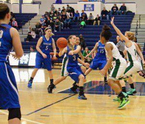 Megan Larabee of Oakridge assists on the Hannah Reinhold 3-pointer. Photo/Jason Goorman