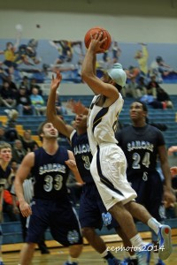 BJ Nahal takes a shot for Grand Haven. Photo/Carol Cooper