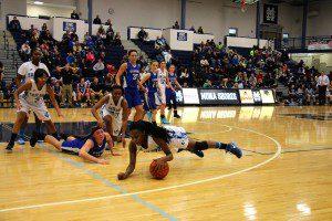 Mona Shores' Jordan Walker dives for the loose ball. Photo/Jason Goorman