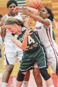 Tasheyana Wyrick fights the ball away from Waylan Union's Caroline Miller. Photo/Joe Lane
