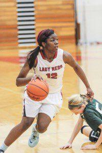 Mardrieka Cook drives up the court for Muskegon. Photo/Joe Lane