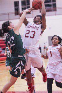 Jayshonna Blackshire gets fouled on the drive by Hesperia's Kaycee Jackson. Photo/Joe Lane