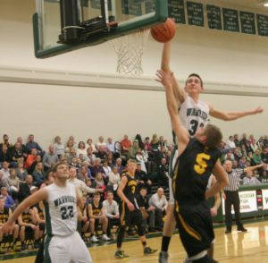 Jacob Ray gets up for the block on Homecoming night. Photo/Scott Stone
