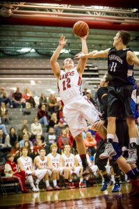 Spring Lake #12 Mark Williamson hits the fade away jumper against Oakridge #11 Nate Whar photo/Tim Reilly