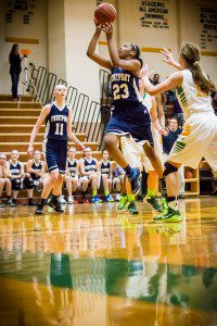 Fruitport #23 Lyana Brown drives to the hoop photo/Tim Reilly