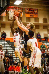 MCC #21 Nate Jones battles Heights #2 Pherrius Flowers for the rebound photo/ Tim Reilly