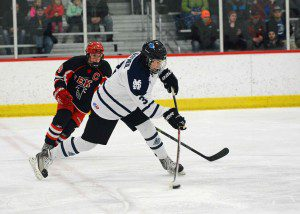 Mona Shores senior captain Nathan O'Neil (3) fires a shot from the point on a Mona Shores power play.  Photo/Eric Sturr