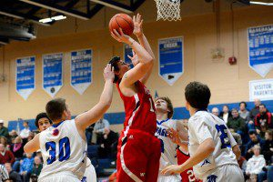 Whitehall's Noah Trombley (10) puts in a rebound over three Montague defenders.  Photo/Eric Sturr