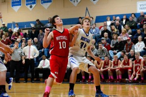 Whitehall's Noah Trombley (10) and Montague's Caleb Semelbauer (34) battle for position in the paint.  Photo/Eric Sturr