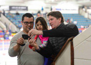Redwings coach Mike Babcock poses for a selfie with some appreciative fans.  Photo/Eric Sturr