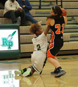 Camaryria Williams goes for the steal from Ludington's Madilyn Shank.