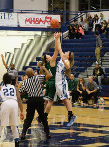 Reeths-Puffer's Delaney Bolles goes for the opening jump ball against Mona Shores' Kelsey Wolffis. Photo/Jason Goorman