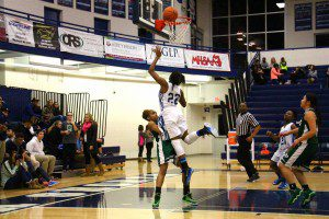 Jordan Walker hits the layup over Reeths-Puffer's Camaryia Williams. Photo/Jason Goorman
