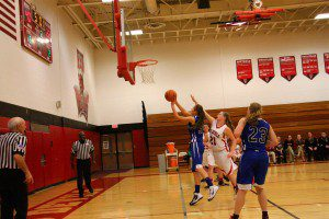 Allyson Richards goes in for the layup as Holton's No. 21 Brandi Taylor tries to block the shot. Photo/Jason Goorman