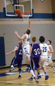 Spencer Landis slashes to the basket past Montague's No. 44 Joe Marsh. Photo/Steve Gunn
