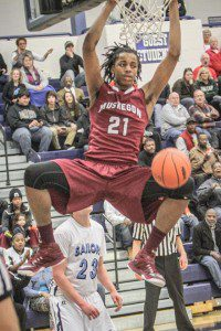 Deyonta Davis on the dunk for Muskegon. Photo/Joe Lane