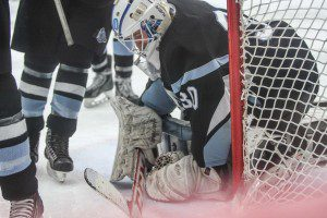 Mona Shores goaltender Jacob VanderLee covers up the puck during Wednesday's action against Reeths-Puffer. Photo/Joe Lane
