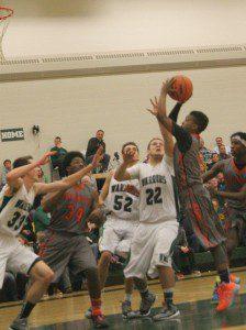 Antonio Jones goes up for the shot in the lane. Photo/Scott Stone