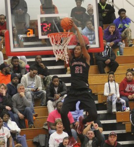 Muskegon's Deyonta Davis gets up for the dunk. Photo/Scott Stone