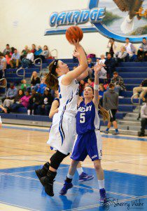 Hannah Reinhold goes up for the shot as Shelby's Deanna Gray plays defense.