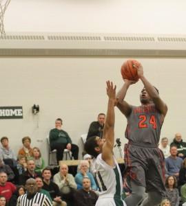 Demonte Jones goes up for the shot over WMC's Jared Varnado. Photo/Scott Stone