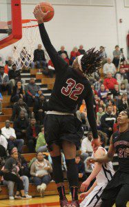 Joeviair Kennedy glides in for the Muskegon dunk. Photo/Scott Stone