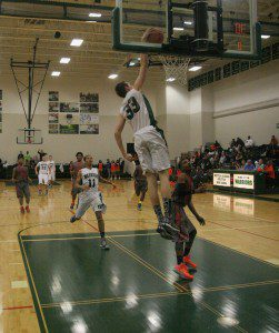 Jacob Ray goes in for the WMC dunk. Photo/Scott Stone