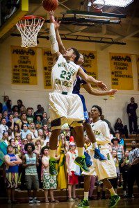 MCC #23 Lamar Jordan drives to the hoop as Shores #3 Darece Roberson attempt the block photo/Tim Reilly