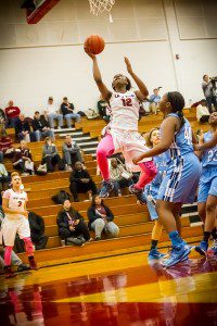 Muskegon #12Mardrekia Cook drives to the hoop photo/Tim Reilly
