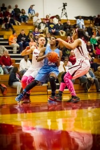 Mona Shores #22 Jordan Walker drives to the hoop against Muskegon #3Shawnteanna Dame photo/Tim Reilly