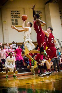 MCC #4 Dom Woodard attempts the shot while OV #2Matias Keyes skies for the block