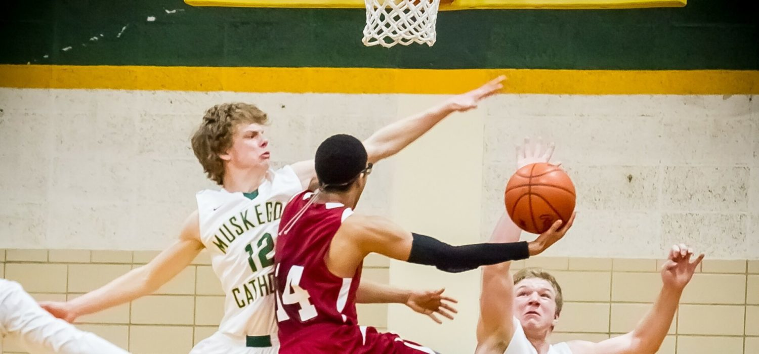 Photo gallery from Orchard View and Muskegon Catholic boys basketball matchup
