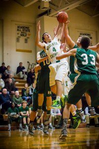 MCC's Dom Woodard gets up against a host of Warriors to grab the offensive rebound. Photo/Tim Reilly