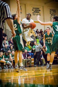 Tommy Scott drives the lane for MCC. Photo/Tim Reilly