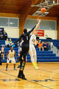 Marco Visconti gets up for the opening tipoff against Oakridge's James Cooper II. Photo/Sherry Wahr