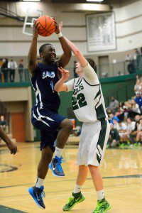 Shores' D'Quintaye Ross (1) takes the ball in for a layup against Puffers' Joey Olson (22).  Photo/Eric Sturr