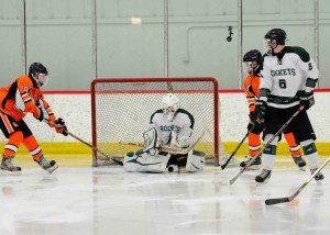 Reeths Puffer goalie Wil Mierz shuts down a Rockford scoring chance.  Photo/Eric Sturr