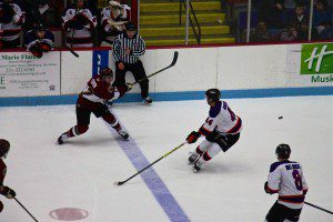 Muskegon's David Keefer sends the puck into Youngstown zone. Photo/Jason Goorman
