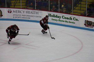 Jack Rowe moves the puck up the ice with Muskegon captain No. 6 Christian Wolanin. Photo/Jason Goorman