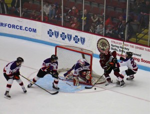 Christian Wolanin goes for the puck in front of the Youngstown net. Photo/Jason Goorman