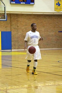 MCC's Will Roberson Jr. dribbles the ball up the floor for MCC. Photo/Jason Goorman