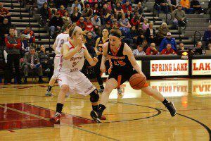 Kristen Reidenbach drives the lane against Spring Lake's Randi Rice. Photo/Jason Goorman