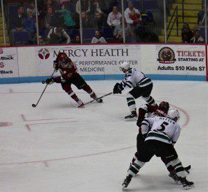 Griffen Molino looks to control the puck for Muskegon. Photo/Jason Goorman
