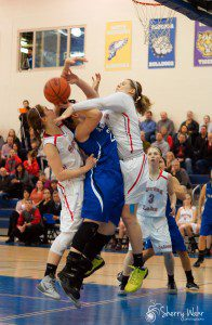 Kelsee Zuidema steps up to stop any chance of an Oakridge bucket. Photo/Sherry Wahr