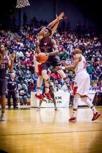 Muskegon's Daryl Kirkland goes up for the shot in the lane. Photo/Tim Rielly