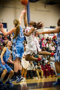 Muskegon #12 Mardrieka Cook drives on Mona Shores #12 Kelsey Wolffis photo/Tim Reilly