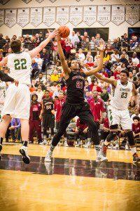 Muskegon #21 Deyonta Davis gets the ball down low photo/Tim Reilly