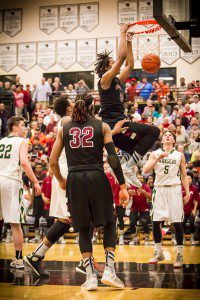 Muskegon #21 Deyonta Davis caps a huge night with a power dunk photo/Tim Reilly